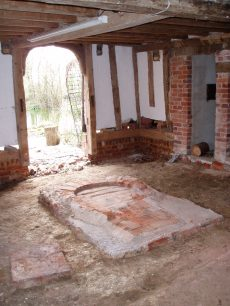 The brewing hearth and the door to the demolished part of the building.