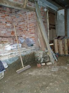 The fireplace after the floor was excavated, early 2009.
