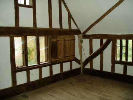 The main bedroom before work started, showing three of the four mullion windows