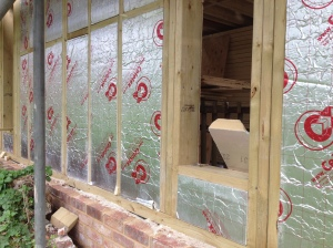 The panels are infilled with insulation, with plywood panelling behind