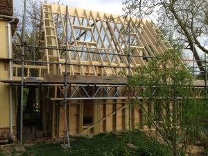 The roof timbers are added, with a Glulam central beam