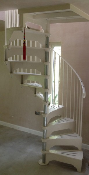 The steel and cast aluminium spiral stairs made by Cottage Craft Spirals just installed - the post has yet to be painted and the screwholes on the handrail will be filled.