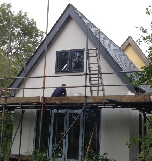 Lime plastering the outside