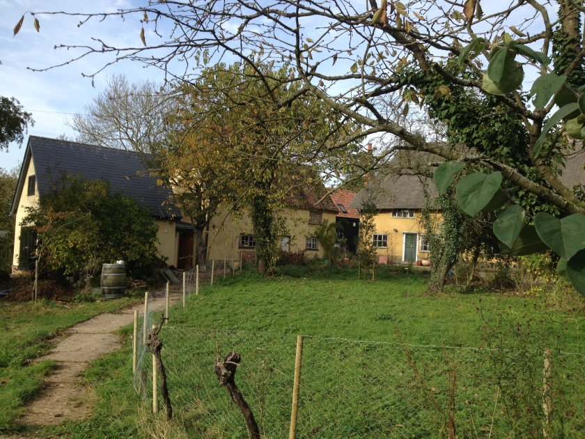 Our home on the left, the ancient farmhouse to the right.