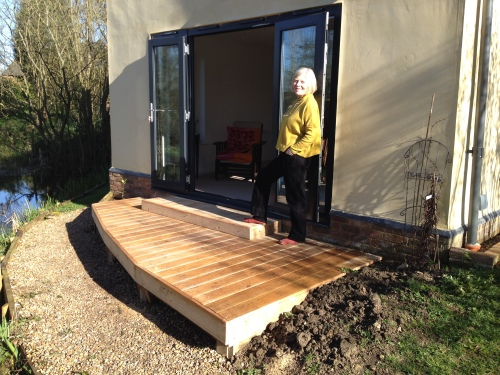 The finished terrace, with step and oak facings